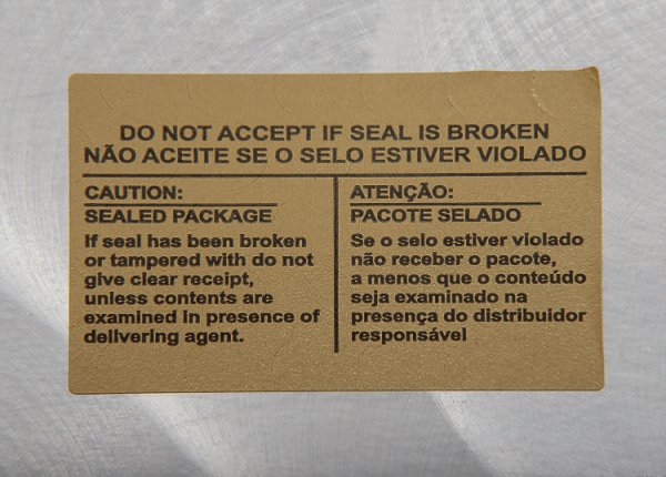 Lacre Adesivo Papel Couchê com Picotes de Segurança